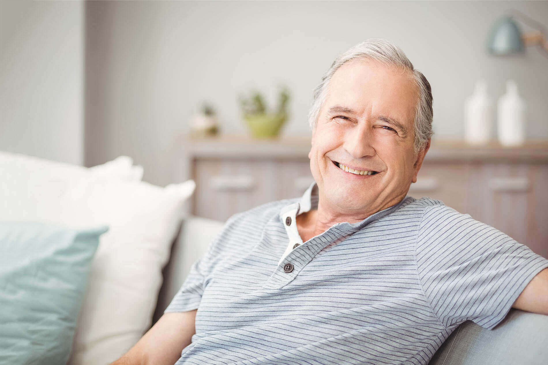 Man on Couch Smiling